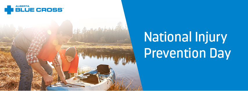 An image of a father and son in life vests, about to put a kayak in a lake. The Alberta Blue Cross logo is in the top left corner and the right hand side of the image has a blue background with National Injury Prevention Day typed in white.